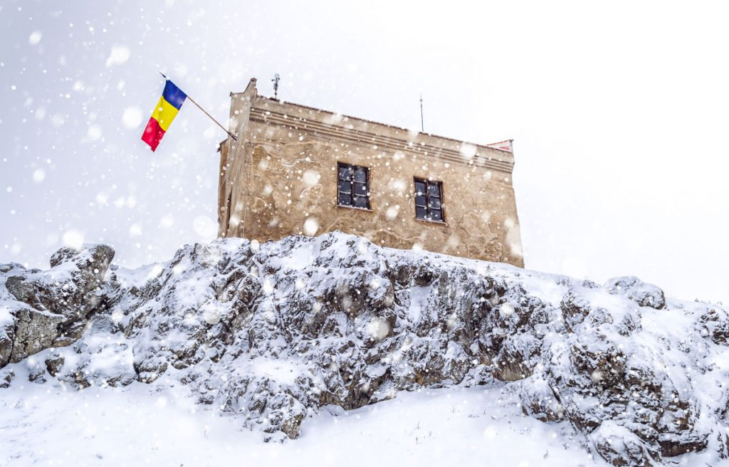 The Romanian flag hanging on the highest building in the citadel.