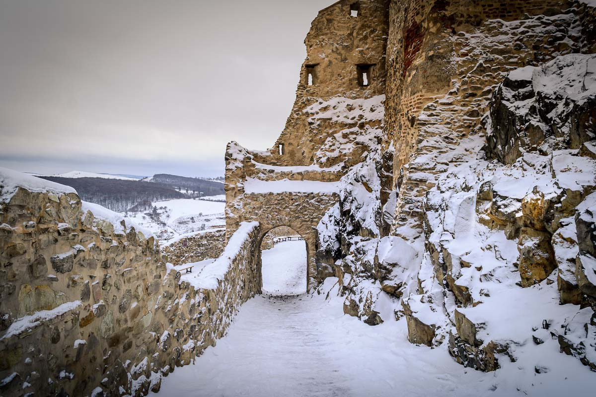 Path covered with snow within the ruins of the fortress.