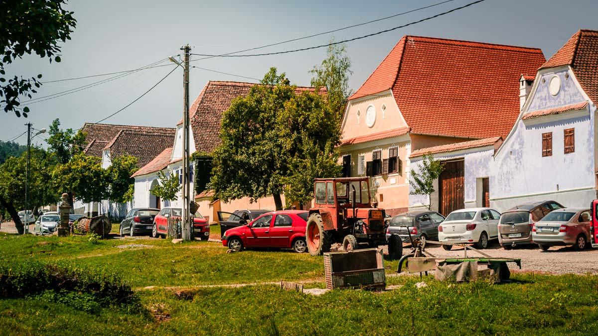 Well maintained houses with a lot of tourist cars.