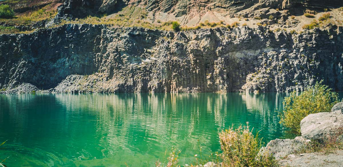 Former basaltic quarry with its green lake.