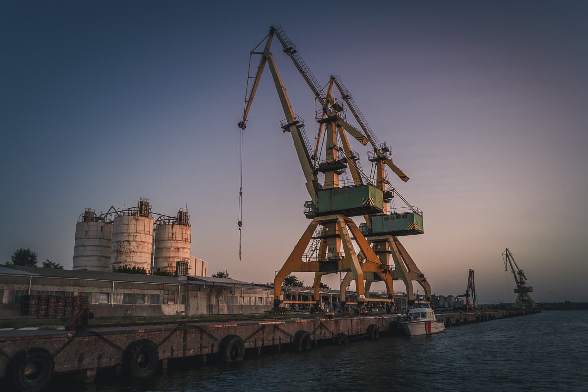 Large port cranes in the port.