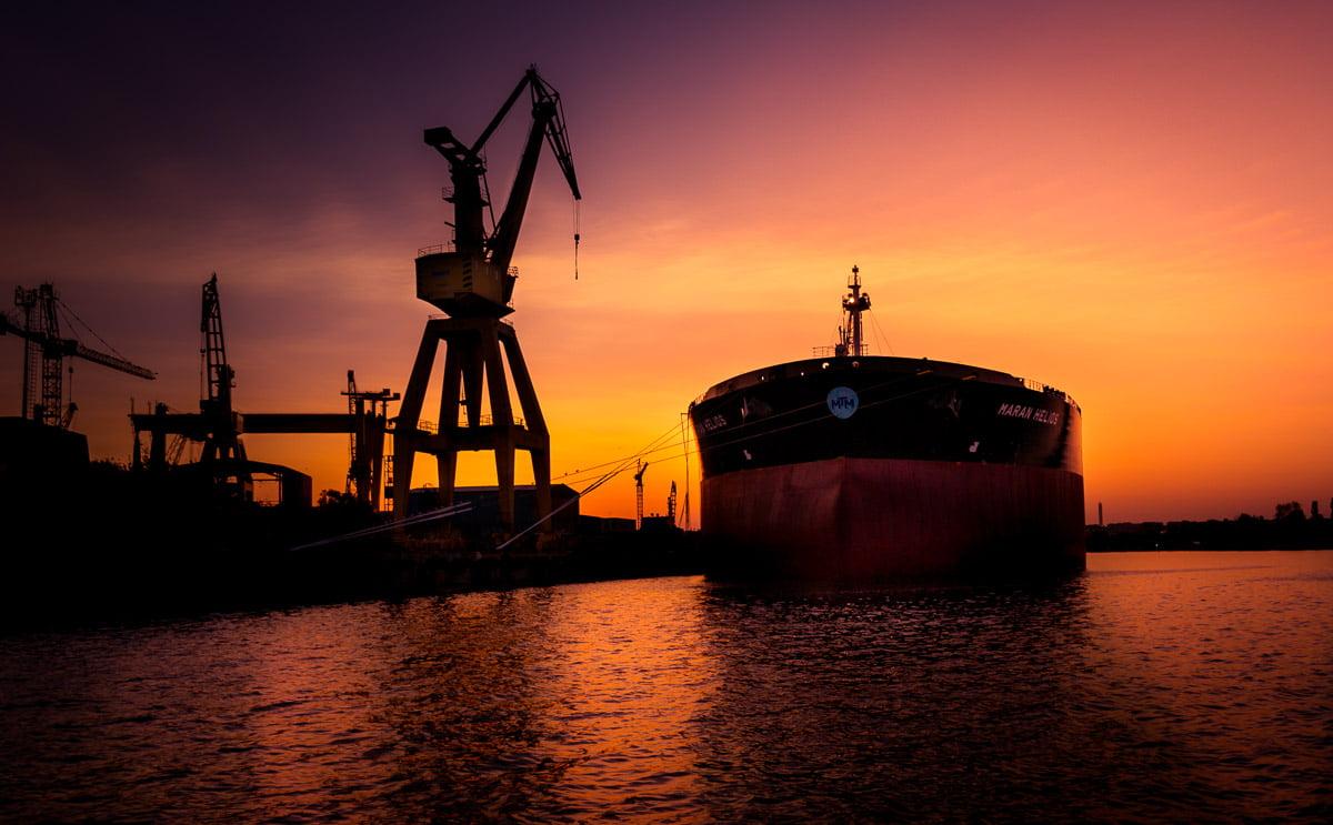 Large oil tanker docked in the shipyard.