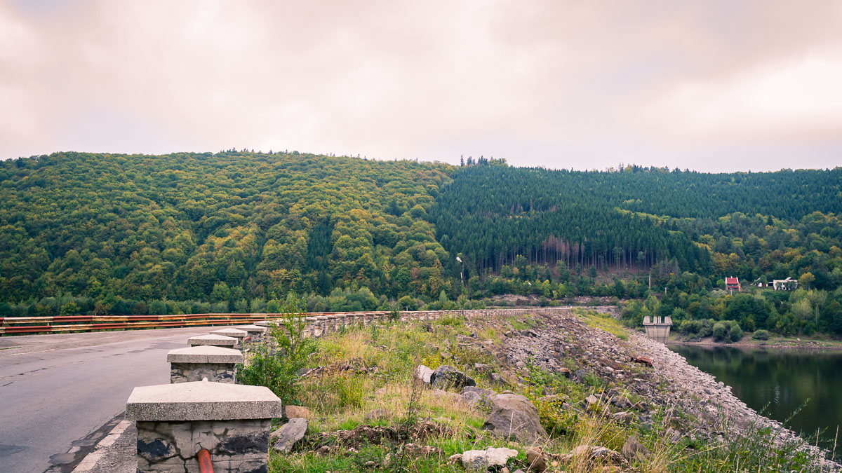 Forested hills next to the dam.
