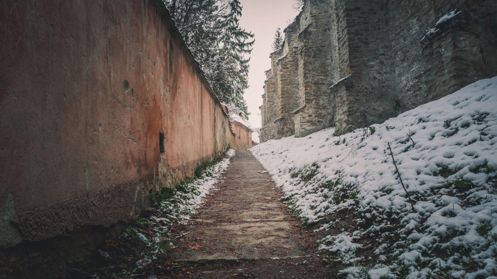 Alley next to the fortification walls of the fortified church.