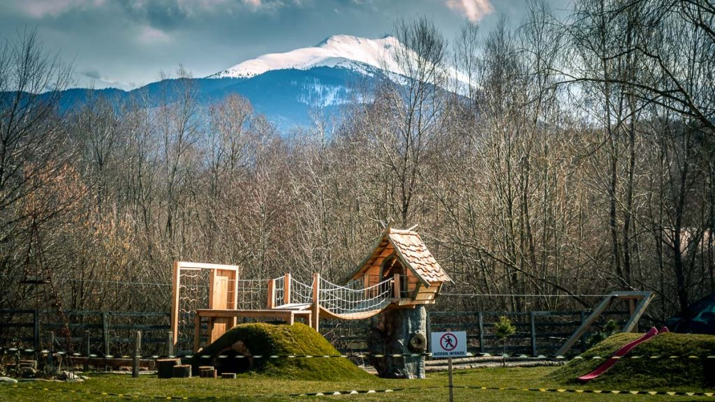 Playground for children at the Clay Castle with the mountains in the background.