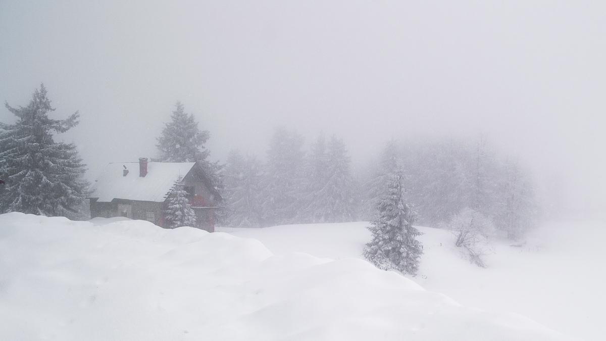 Cabin in Semenic ski resort in dense fog.